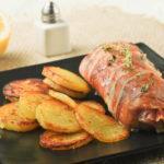 Rollito de rape relleno de calabacín y tomates al limón